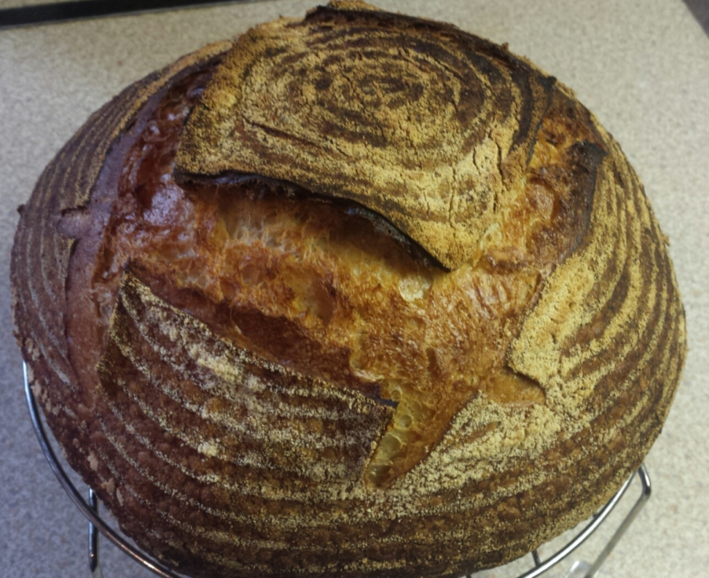 A beautifully well-risen white sourdough boule- at only 71% hydration